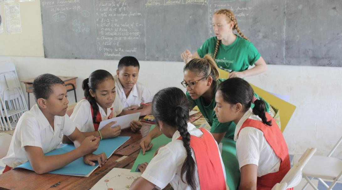 A volunteer teaching in Samoa oversees a classroom activity.